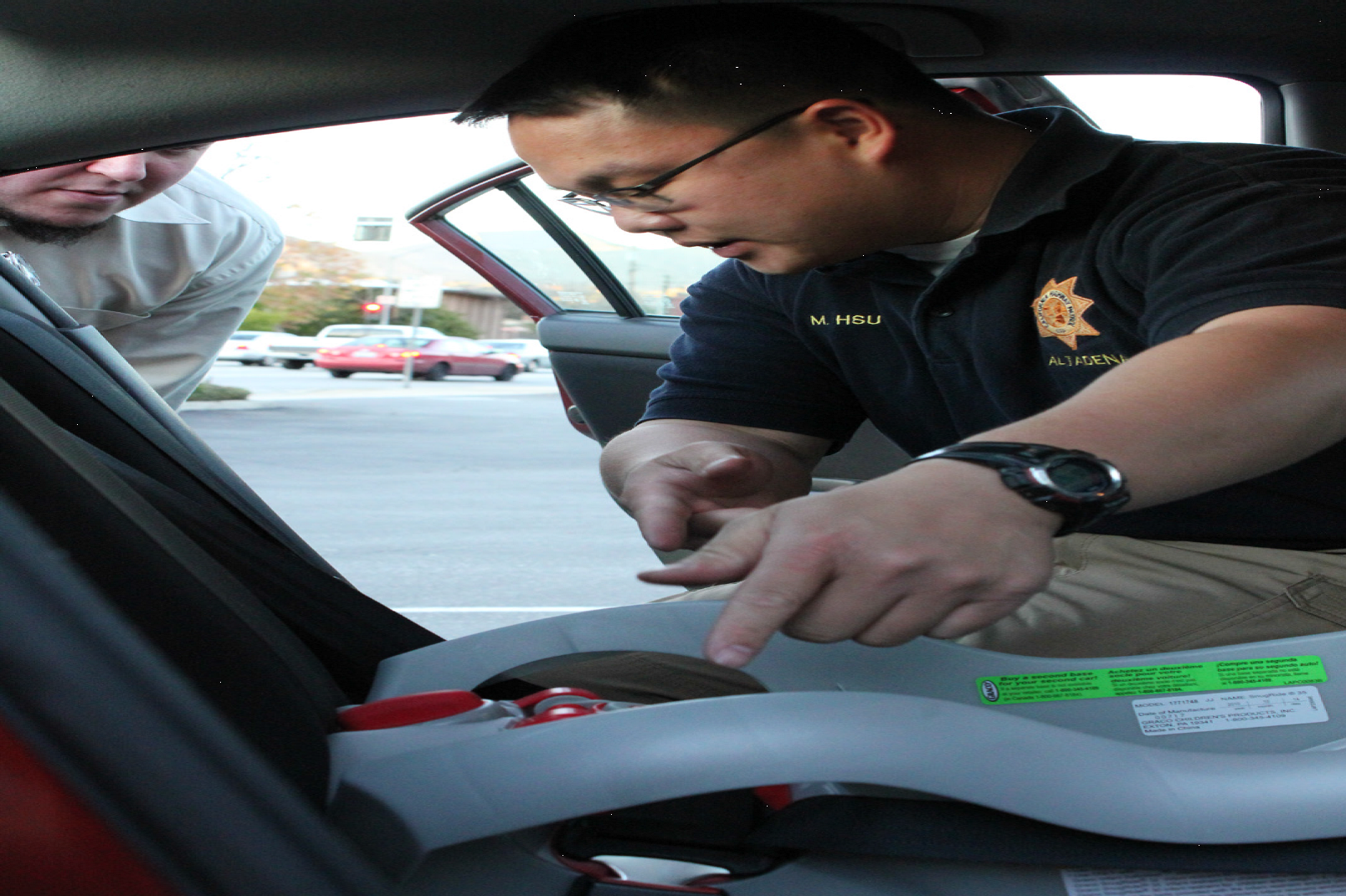 CHP Officer inspecting car seat
